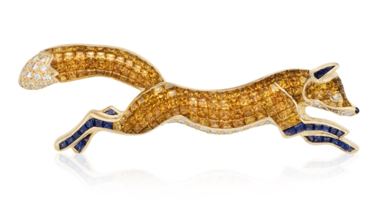 A brooch with orange and blue sapphires, and diamond accents. ©2020 Christie's Images Limited.